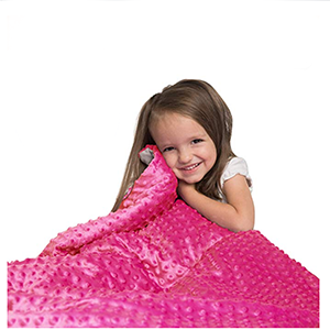 Small child wrapped up in Hazli pink weighted blanket